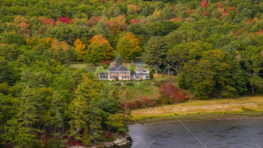 An isolated waterfront home, colorful autumn trees, Phippsburg, Maine Aerial Stock Photos | AX147_407.0000000