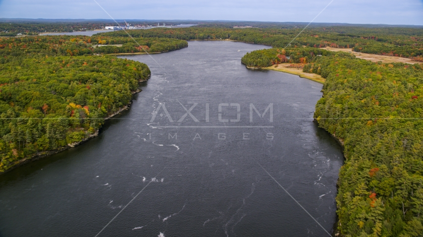 The Kennebec River, shores lined with colorful trees, Phippsburg, Maine Aerial Stock Photos | AX147_408.0000000