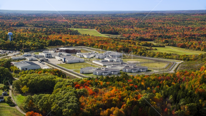 Maine State Prison by colorful forest, autumn, Warren, Maine Aerial Stock Photos | AX148_064.0000000