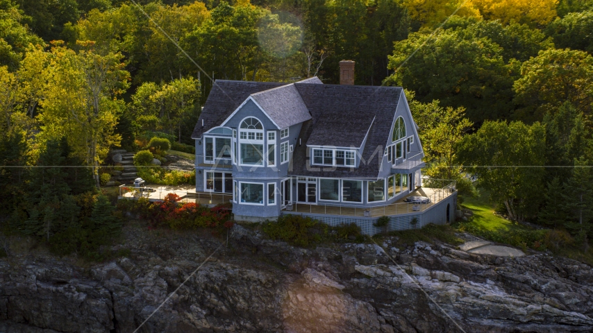 A mansion on a rocky shore in autumn, Bar Harbor, Maine Aerial Stock Photos | AX148_184.0000221