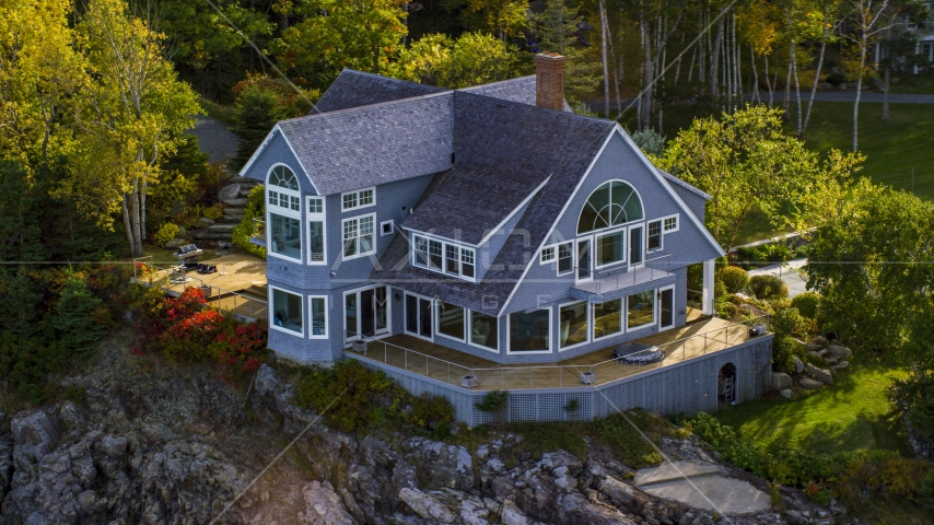 A waterfront mansion on a rocky coast, autumn, Bar Harbor, Maine Aerial Stock Photos | AX148_185.0000000