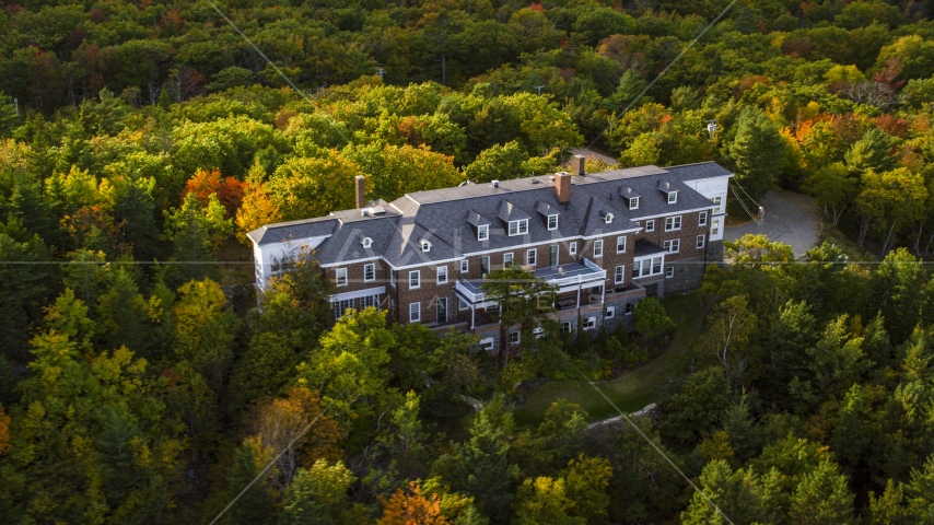 An isolated mansion, trees with autumn leaves, Bar Harbor, Maine Aerial Stock Photos | AX148_187.0000000