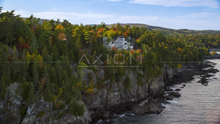 Waterfront homes on a cliff in autumn, Bar Harbor, Maine Aerial Stock Photos | AX148_191.0000000