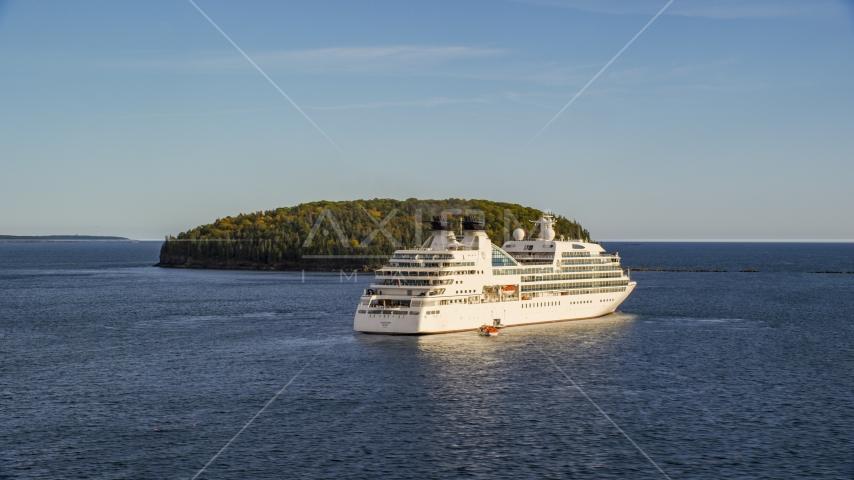 A cruise ship sailing past a tiny island, Bar Harbor, Maine Aerial Stock Photos | AX148_200.0000250