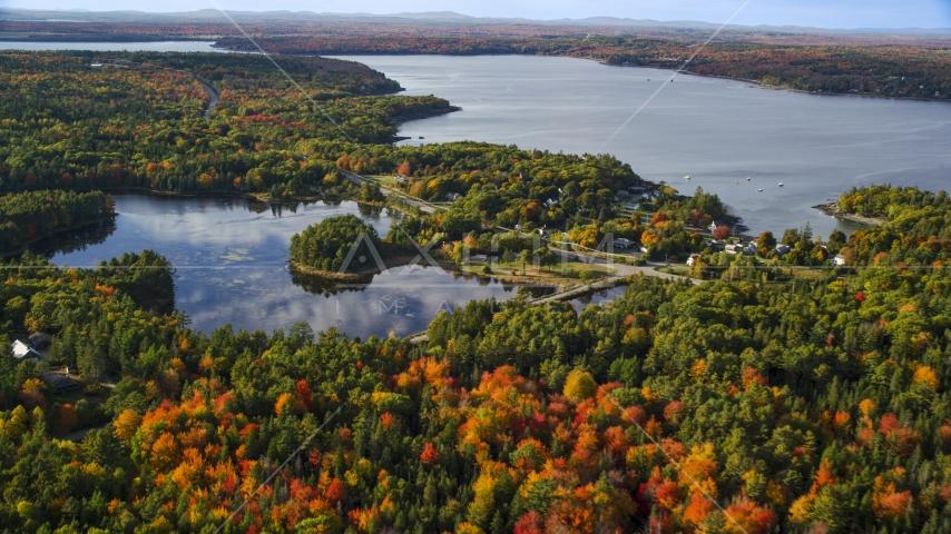 Fall foliage around a pond and coastal town, Bar Harbor, Maine Aerial Stock Photos | AX148_230.0000028