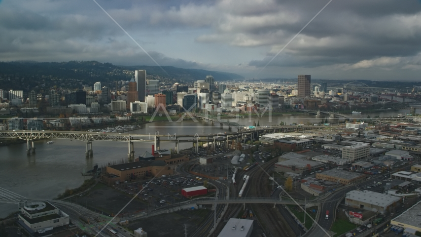 Willamette River and bridges with a view of Downtown Portland in autumn, Oregon Aerial Stock Photos | AX153_053.0000346F
