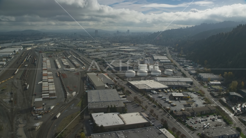 Warehouses and train yard in an industrial area, Northwest Portland, Oregon Aerial Stock Photos | AX153_063.0000297F