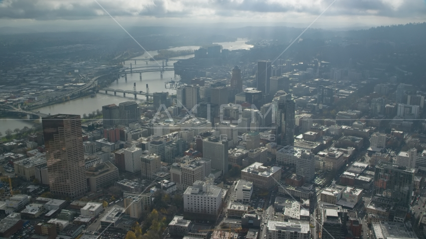 The Willamette River and bridges near skyscrapers in Downtown Portland, Oregon Aerial Stock Photos | AX153_077.0000332F