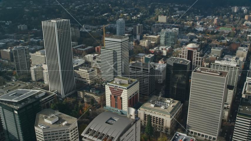 Wells Fargo Center beside high-rises in Downtown Portland, Oregon Aerial Stock Photos   AX153_081.0000056F
