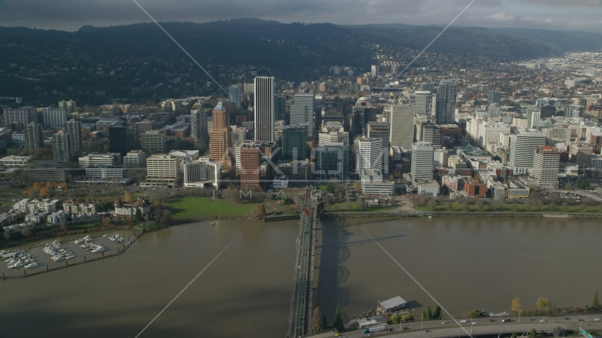 Downtown Portland skyscrapers across the Hawthorne Bridge and the Willamette River, Oregon Aerial Stock Photos | AX153_083.0000281F