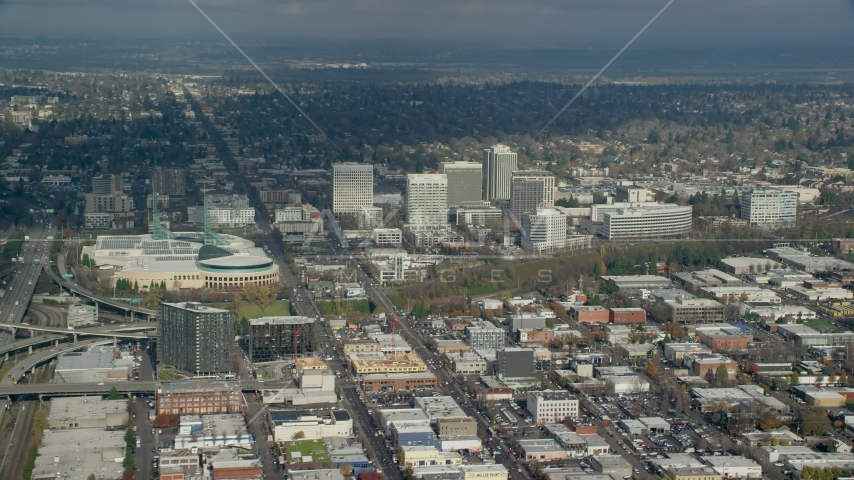 The Oregon Convention Center near office buildings in Lloyd District of Portland, Oregon Aerial Stock Photos | AX153_091.0000094F