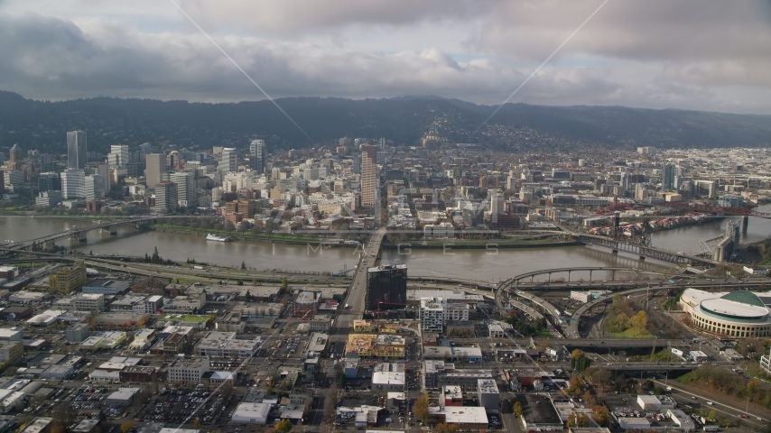 The Burnside Bridge and skyscrapers in Downtown Portland, Oregon Aerial Stock Photo AX153_104.0000091F | Axiom Images