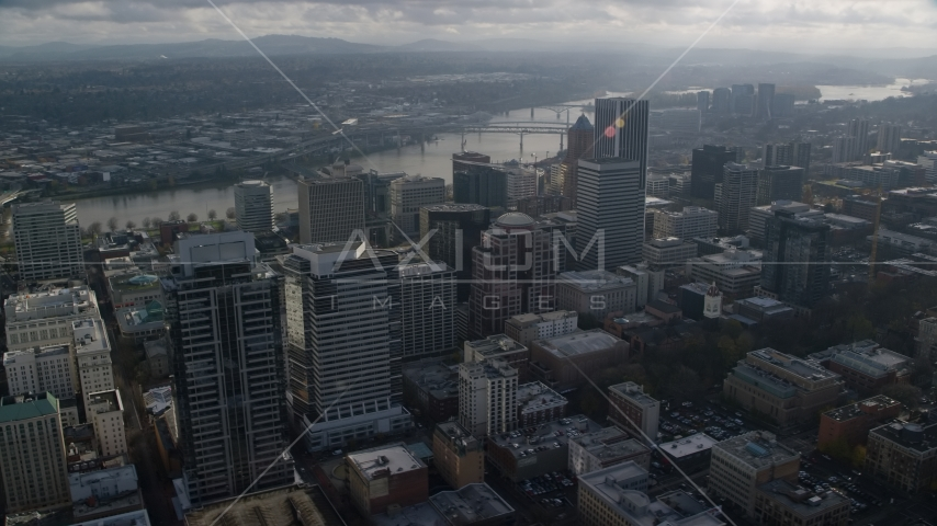 Skyscrapers near bridges spanning the Willamette River in Downtown Portland, Oregon Aerial Stock Photos | AX153_110.0000000F