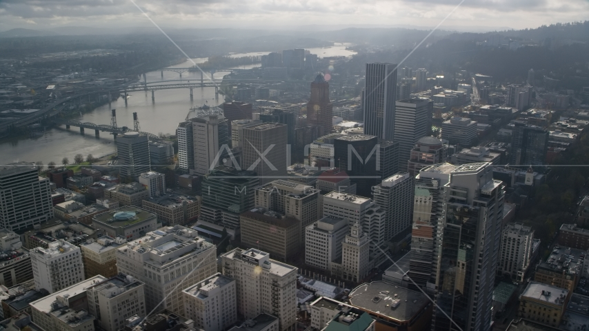 Skyscrapers beside bridges spanning the Willamette River in Downtown Portland, Oregon Aerial Stock Photos AX153_110.0000174F