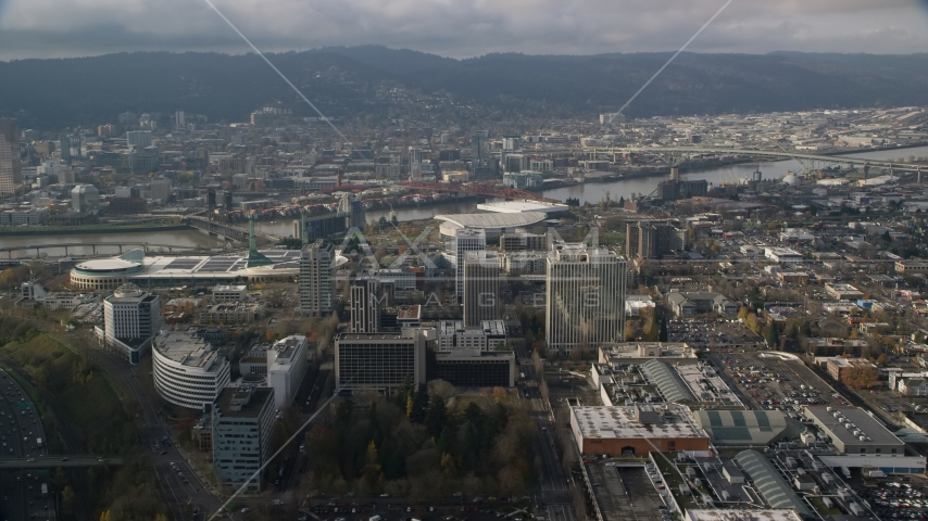 Convention center and office buildings near Moda Center and the Willamette River, Portland, Oregon  Aerial Stock Photo AX153_111.0000000F | Axiom Images
