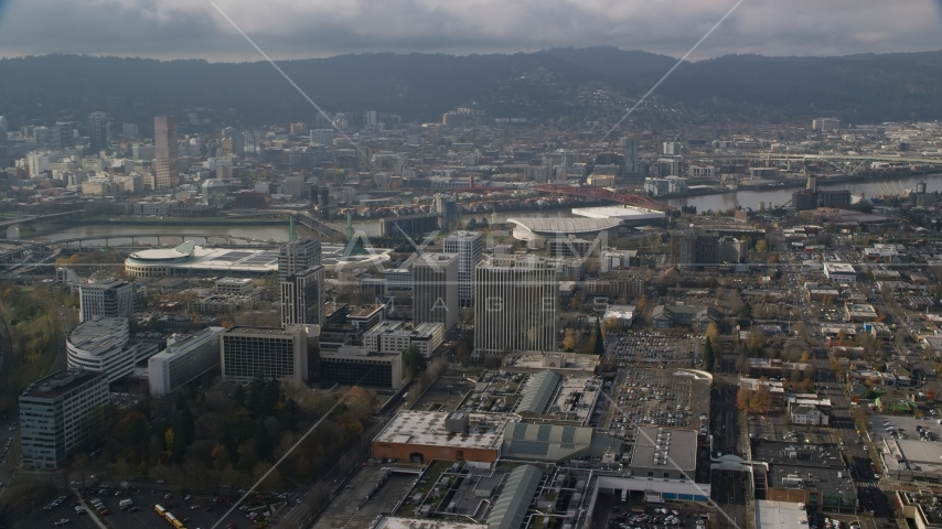 Convention Center, office buildings and Moda Center with Downtown Portland, Oregon in the background Aerial Stock Photos | AX153_111.0000135F