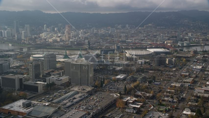 Downtown Portland behind office buildings and Moda Center, Oregon  Aerial Stock Photo AX153_111.0000319F | Axiom Images