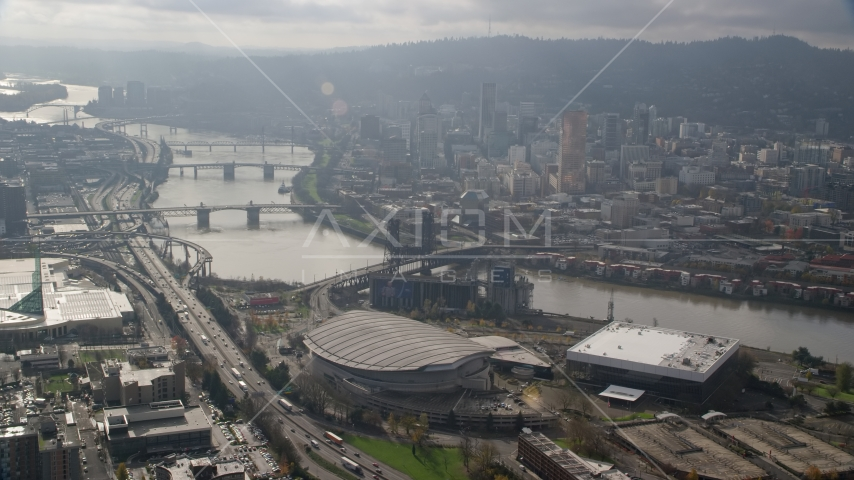 Bridges over the Willamette River, skyscrapers in Downtown Portland, and Moda Center in Oregon Aerial Stock Photos | AX153_113.0000312F