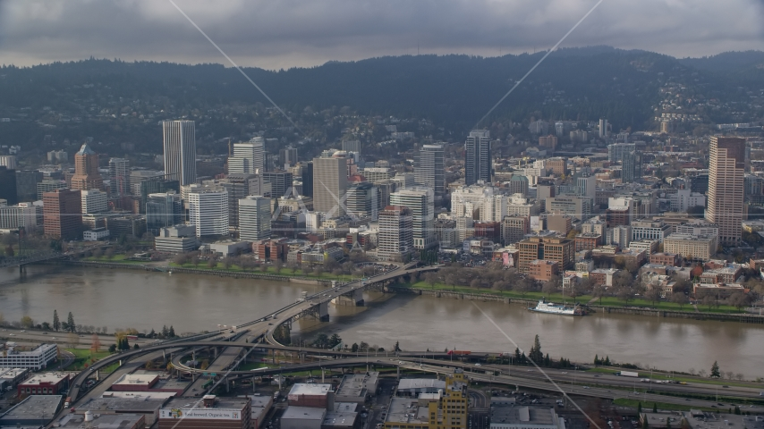 Downtown Portland skyscrapers across the Morrison Bridge and the Willamette River, Oregon Aerial Stock Photos | AX153_121.0000355F