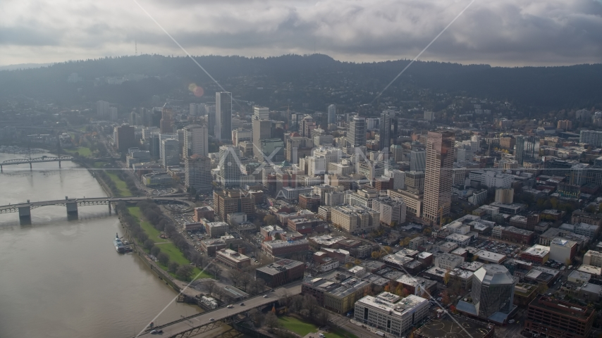 Skyscrapers and high-rises near the river in Downtown Portland, Oregon Aerial Stock Photos | AX153_123.0000000F