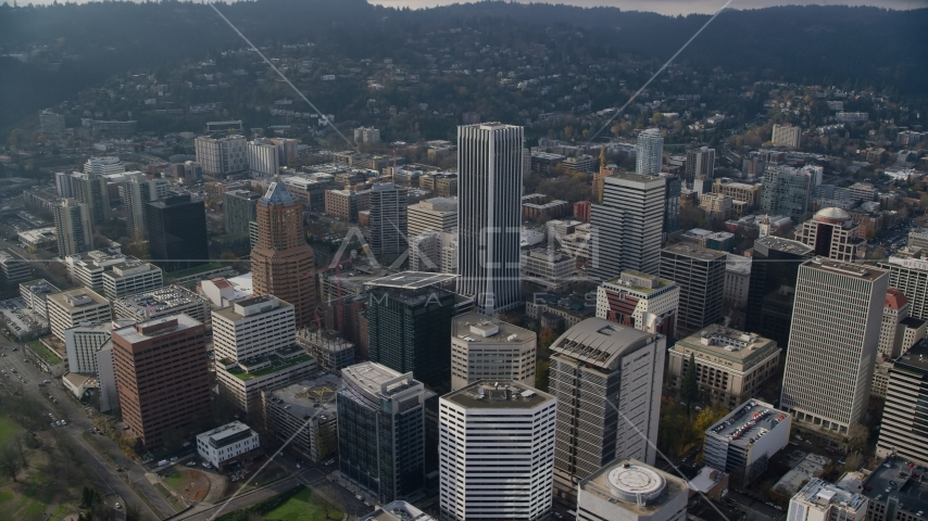 A view of KOIN Center, Wells Fargo Center, and high-rises in Downtown Portland, Oregon Aerial Stock Photos | AX153_125.0000231F