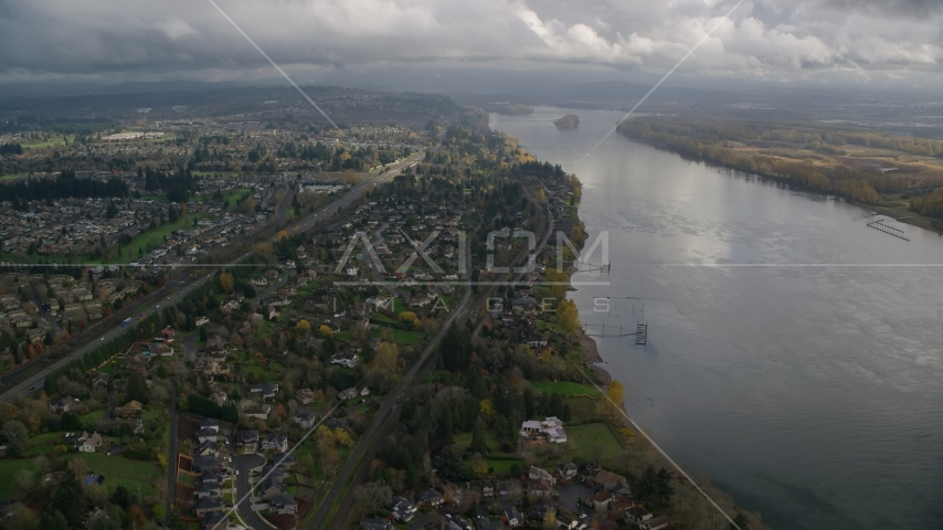 Suburban riverfront houses by Highway 14 in Vancouver, Washington Aerial Stock Photos | AX153_141.0000021F