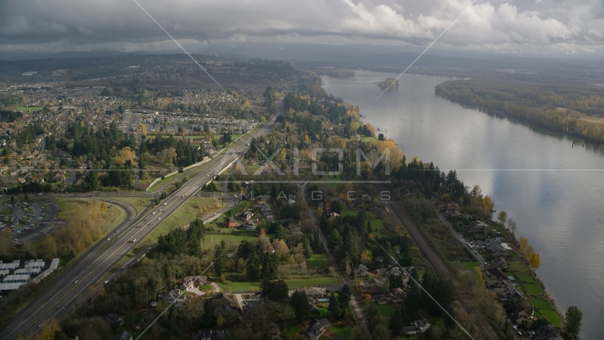 Highway 14 near suburban homes on the Columbia River in Vancouver, Washington Aerial Stock Photo AX153_142.0000335F | Axiom Images