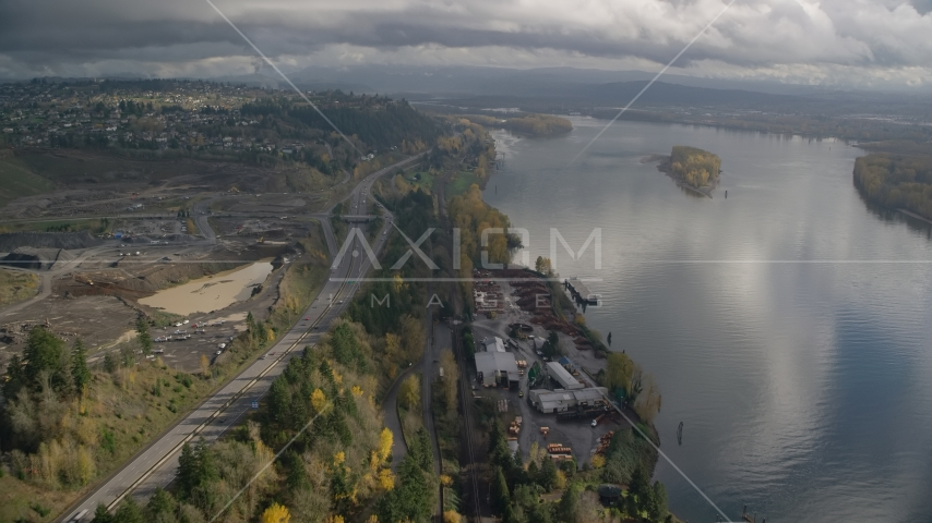 A lumber mill on the Columbia River near Highway 14, Camas and Vancouver, Washington Aerial Stock Photos AX153_145.0000185F | Axiom Images