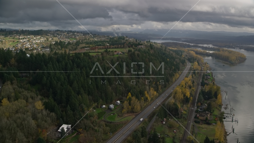 High above Highway 14 and hilltop suburban homes, autumn, Camas, Washington Aerial Stock Photo AX153_146.0000208F | Axiom Images