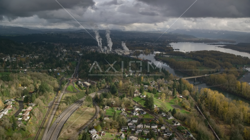 High above Highway 14 looking out toward a paper mill in Camas, Washington Aerial Stock Photos | AX153_149.0000054F