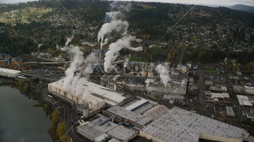 The Georgia Pacific Paper Mill with steam rising in Camas, Washington Aerial Stock Photos | AX153_153.0000255F