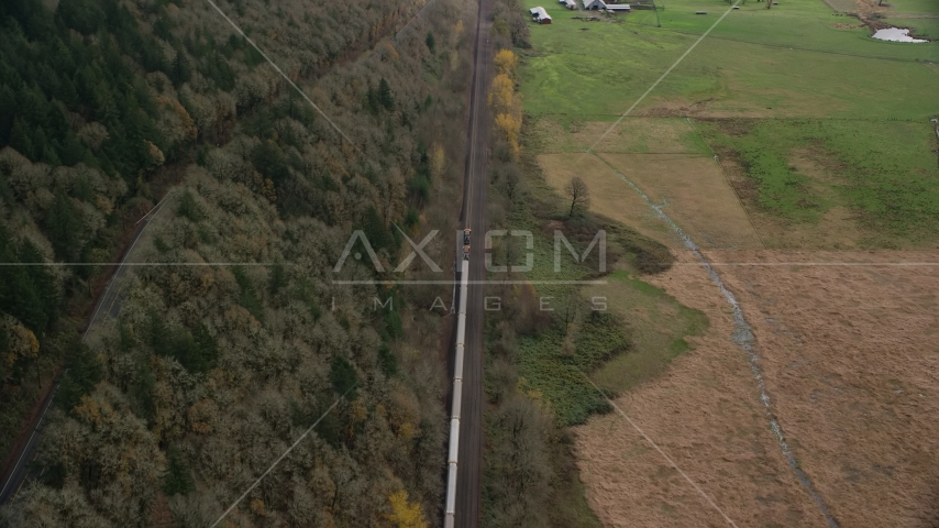A train traveling past open fields in Washougal, Washington Aerial Stock Photos | AX153_179.0000261F