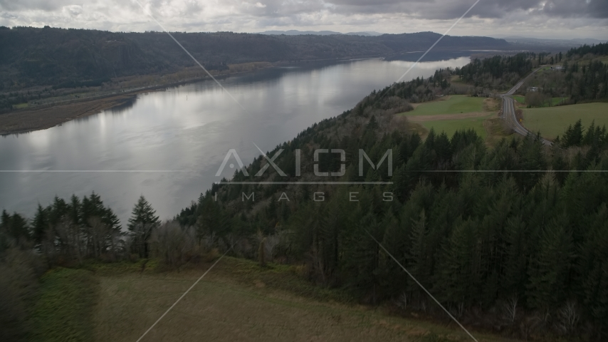 Columbia River Gorge seen from tree covered cliff, Washington Aerial Stock Photos | AX153_188.0000183F