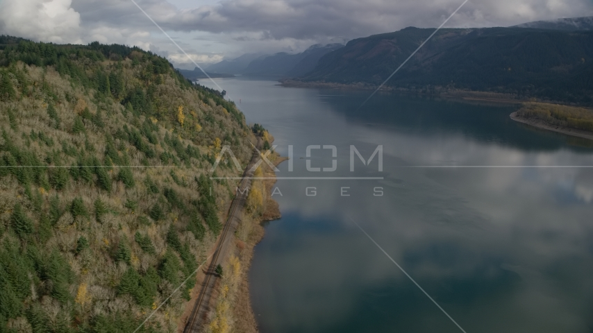 Train tracks at the bottom of a cliff in Columbia River Gorge, Oregon Aerial Stock Photos | AX154_001.0000000F