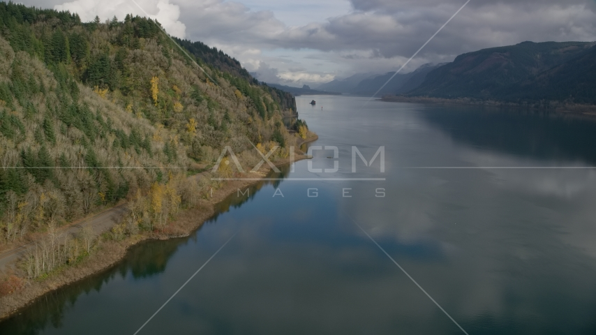 Railroad tracks at the bottom of a cliff in the Columbia River Gorge, Oregon Aerial Stock Photos | AX154_001.0000308F