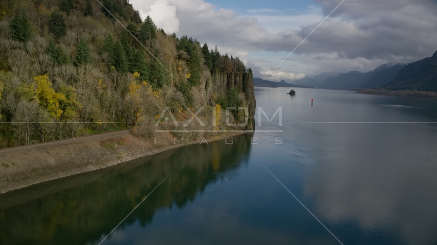 Railroad tracks below a cliff in the Columbia River Gorge, Oregon Aerial Stock Photos | AX154_004.0000307F