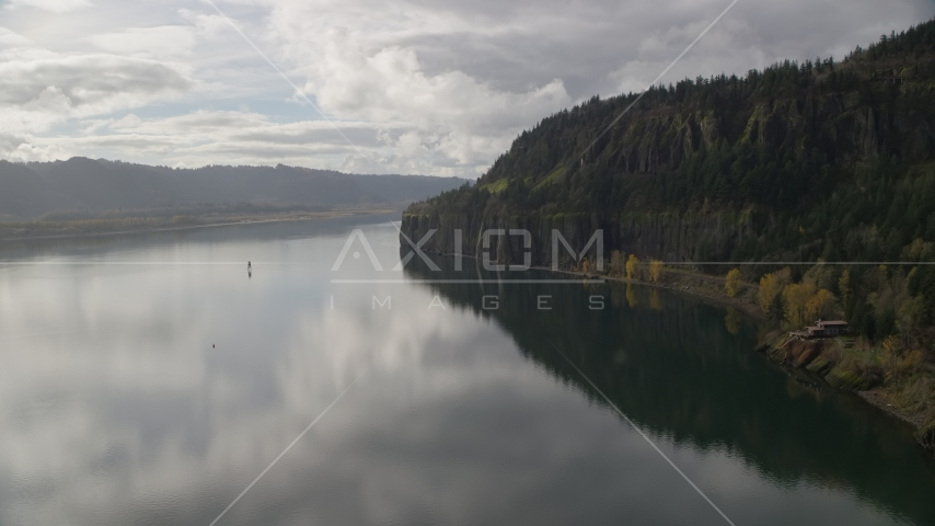 Isolated home beside the river in Columbia River Gorge, Washington Aerial Stock Photo AX154_008.0000000F | Axiom Images