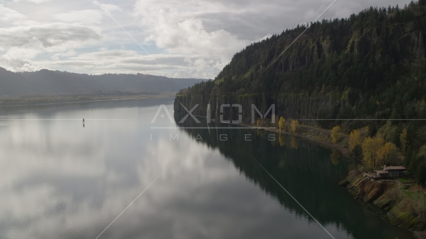 An isolated home overlooking the river in Columbia River Gorge, Washington Aerial Stock Photo AX154_008.0000156F | Axiom Images