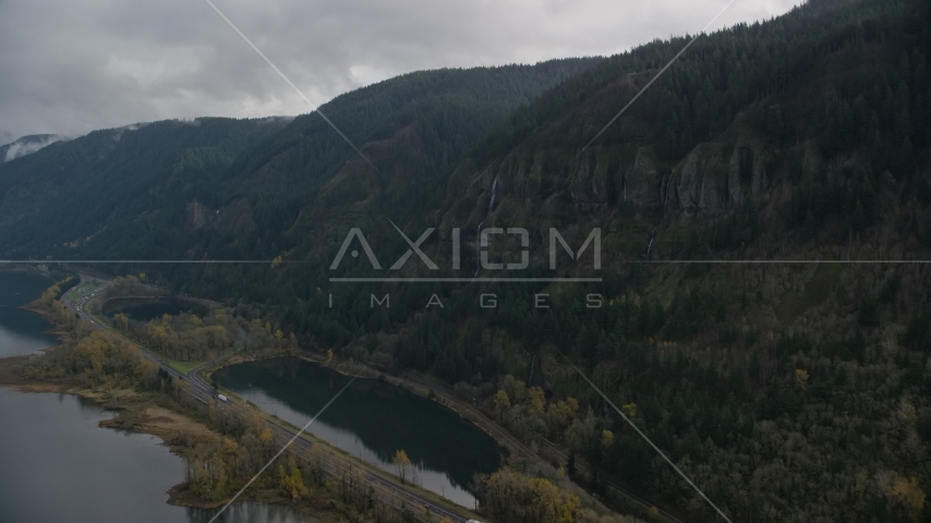 A waterfall on a Columbia River Gorge cliff face in Multnomah County, Oregon Aerial Stock Photos | AX154_018.0000000F
