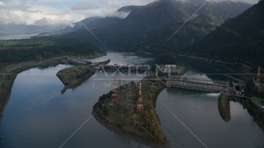 The Bonneville Dam structure in Columbia River Gorge Aerial Stock Photo AX154_029.0000253F | Axiom Images