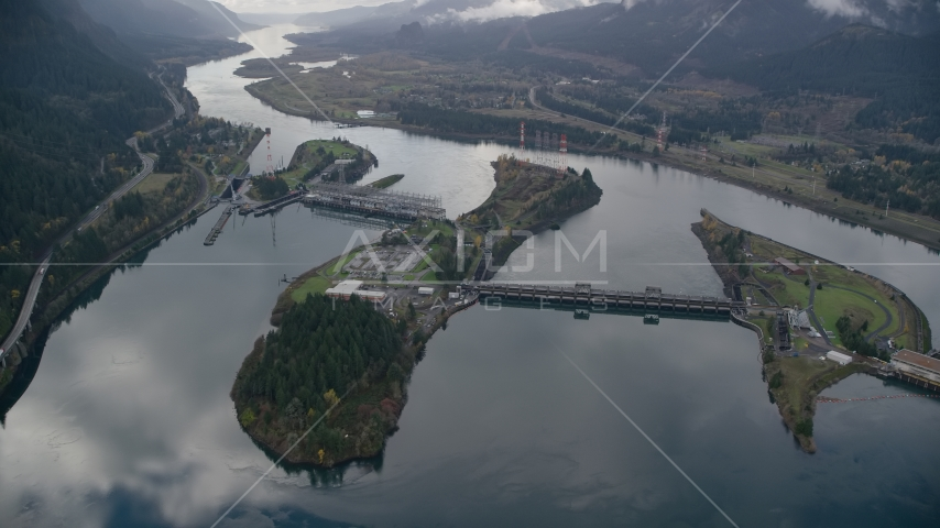 The Bonneville Dam and the Columbia River in the Columbia River Gorge Aerial Stock Photos | AX154_034.0000246F