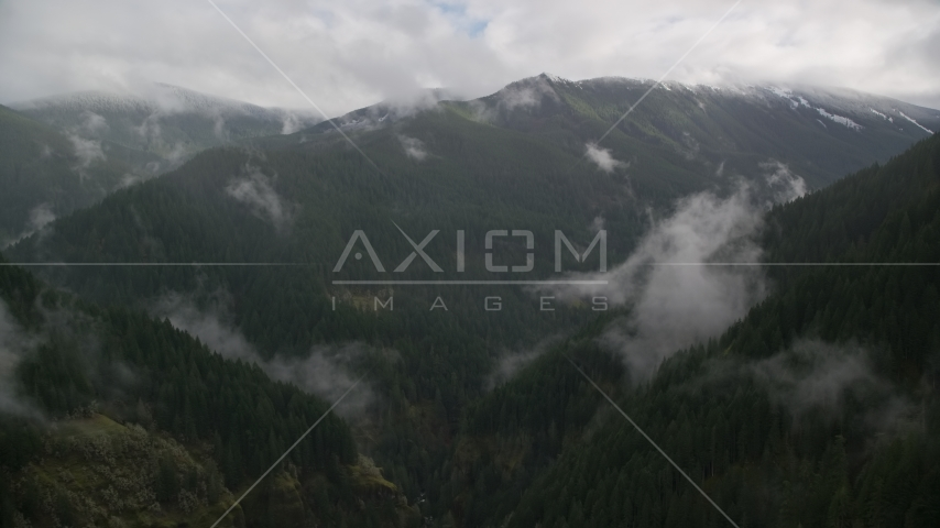 A misty canyon and a mountain ridge with light snow in Cascade Range, Hood River County, Oregon Aerial Stock Photos | AX154_052.0000243F