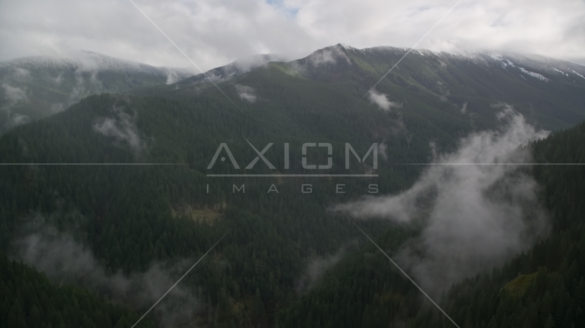A mountain ridge with light snow at the end of a misty canyon in Cascade Range, Hood River County, Oregon Aerial Stock Photos | AX154_052.0000388F
