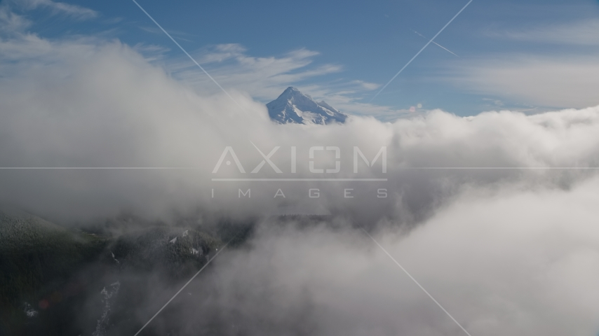 Mount Hood, visible above a layer of thick clouds, Cascade Range, Oregon Aerial Stock Photos | AX154_060.0000000F