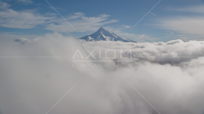 A thick cloud layer around snowy Mount Hood, Cascade Range, Oregon Aerial Stock Photos AX154_062.0000000F