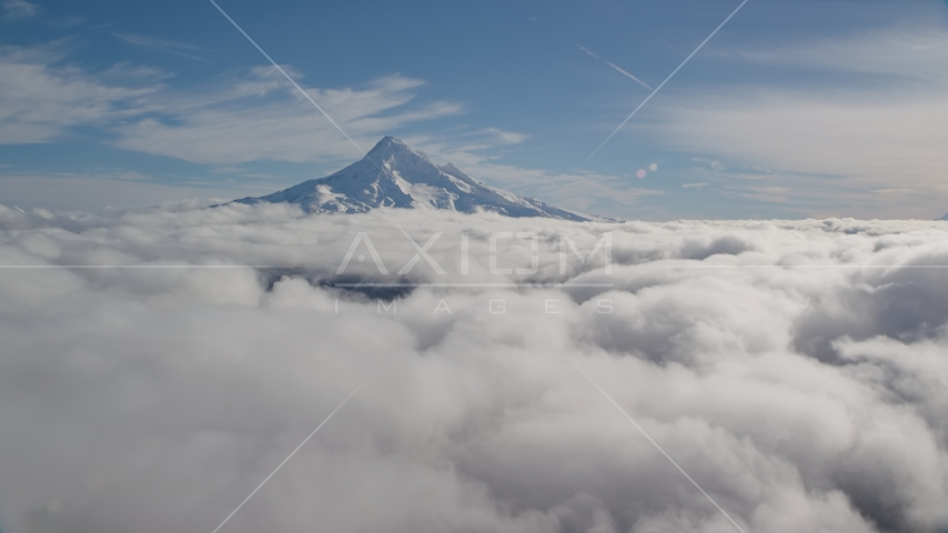 The snowy summit of Mount Hood above the clouds, Cascade Range, Oregon Aerial Stock Photo AX154_064.0000250F | Axiom Images