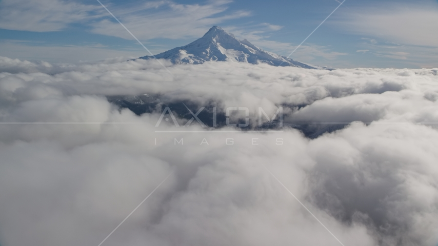 The snowy summit of Mount Hood and low clouds in the Cascade Range, Oregon Aerial Stock Photos | AX154_066.0000182F