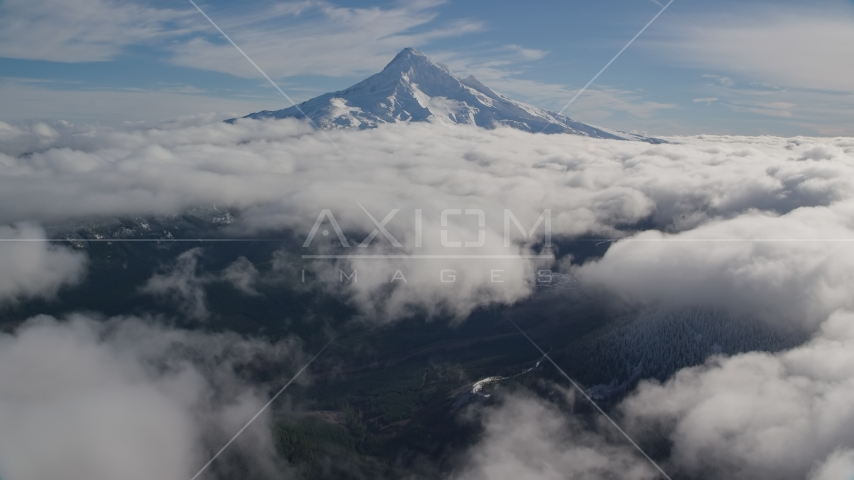 A break in the clouds near the snowy summit of Mount Hood, Cascade Range, Oregon Aerial Stock Photos | AX154_068.0000206F