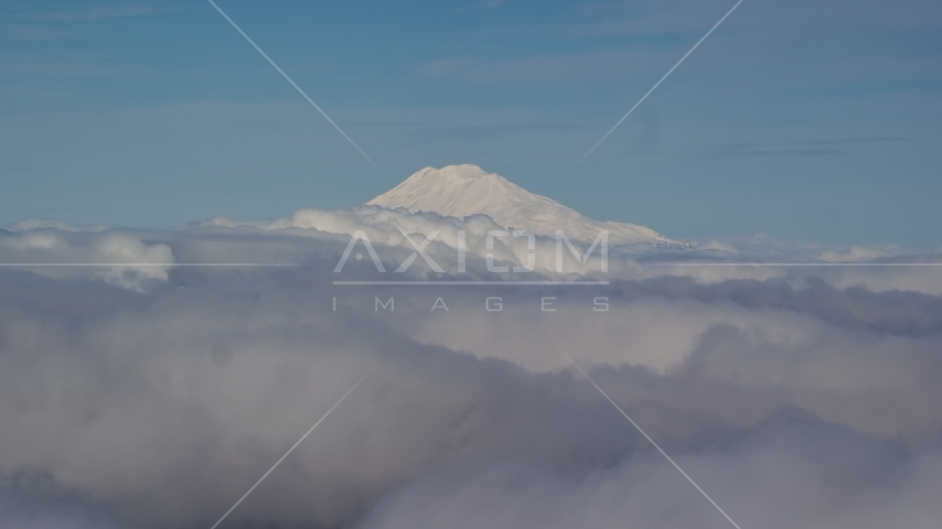 Mt Adams' snowy summit in the distance and low cloud cover, Cascade Range, Oregon Aerial Stock Photos AX154_069.0000000F