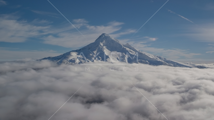 The summit of Mount Hood with snow and low clouds, Mount Hood, Cascade Range, Oregon Aerial Stock Photos AX154_070.0000000F | Axiom Images